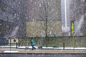 A man makes his way up South Pearl Street as snow falls on Monday, March 23, 2020, in Albany, N.Y.   (Paul Buckowski/Times Union)