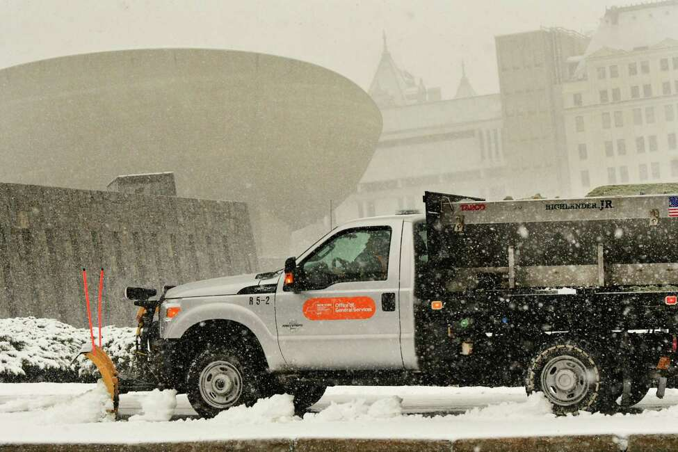 An Office of General Services truck plows a sidewalk along Madison Ave on Monday, March 23, 2020 in Albany, N.Y. (Lori Van Buren/Times Union) ORG XMIT: j=032420_weather