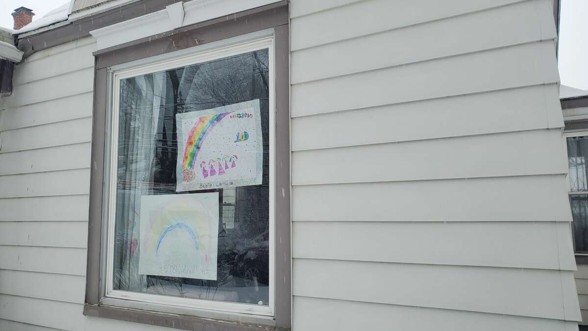 Rainbow pictures in the window of a home in Colonie. Across the globe, rainbows in windows are hanging to symbolize hope and unity during the coronavirus crisis. (Chris Churchill / Times Union)