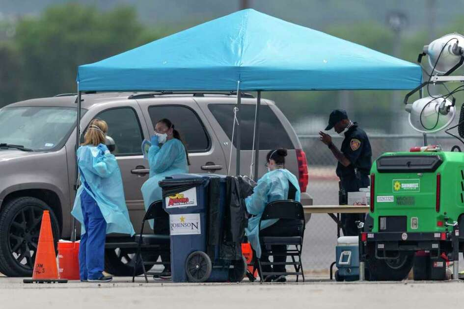 Officials work Thursday, March 19, 2020 at the Freeman Coliseum drive through COVID-19 coronavirus testing location. The City of San Antonio, Bexar County and the South Texas Regional Advisory Council opened the testing center Wednesday.