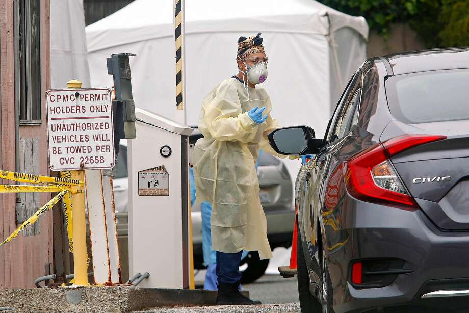 Medical staff work at a Coronavirus testing site at a parking lot at the CPMC Sutter Health California campus on Monday, March 23, 2020 in San Francisco. Photo: Lea Suzuki / The Chronicle