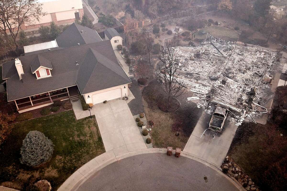 The homes at Melene Court at Country Oak Drive, Thursday, Nov. 15, 2018, in Paradise, Calif. As of this morning, the Camp Fire has burned 140,000 acres. The wildfire is 40% contained. 56 people have died.