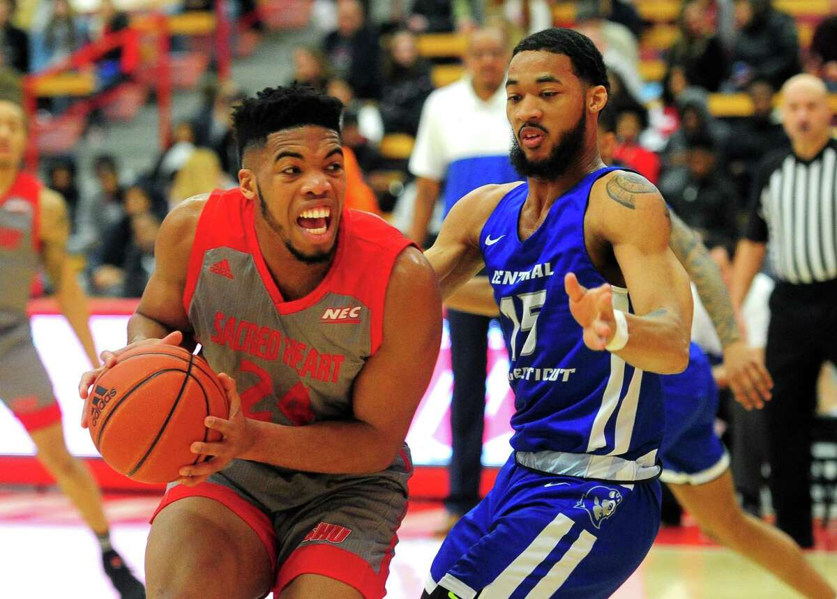 Sacred Heart's E.J. Anosike (24) looks to score as Central Connecticut's Jamir Coleman (15) defends during mens college basketball in Fairfield, Conn., on Wednesday Jan. 15, 2020.