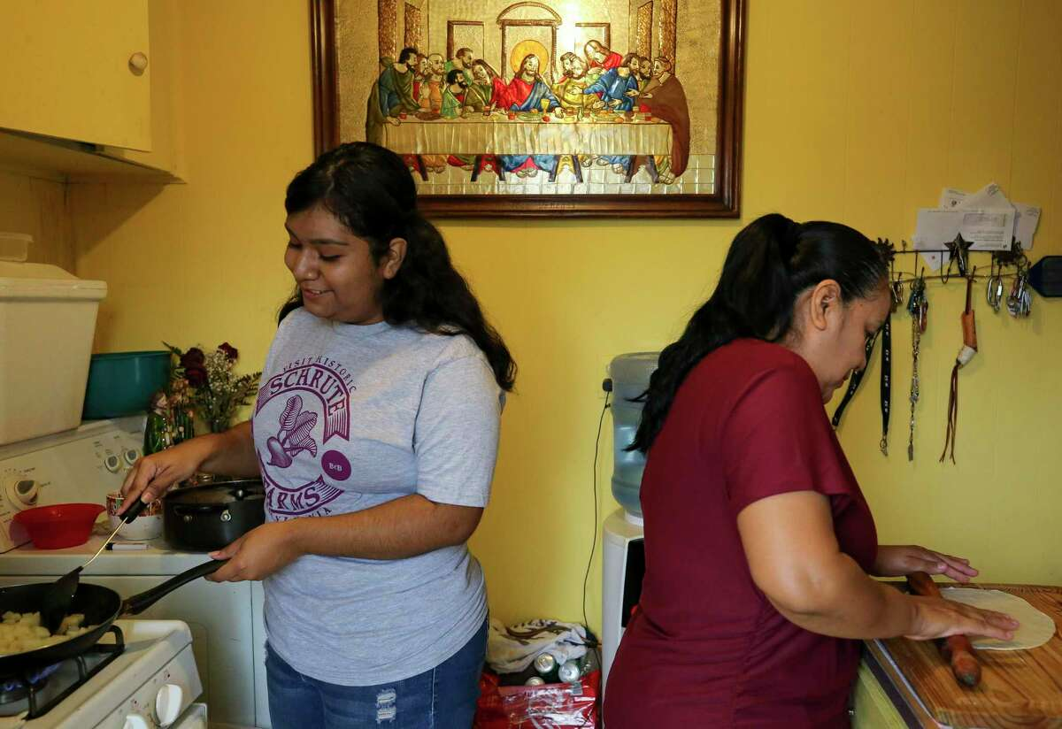 Dolores Venegas, right, and her daughter, Jacqueline Ricalday, 18, prepare breakfast at their home Thursday, March 19, 2020, in Houston. Ricalday, a senior at Northside High School, doesn't know when school and her internship at Texas Children's Hospital will resume, after both were halted due to the new coronavirus pandemic. She has also seen her hours at Marble Slab Creamery slashed because of the virus.