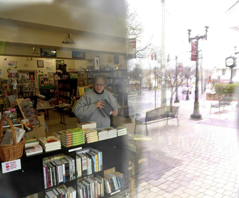 Alice Hutchinson, owner of Byrd's Books, will be closing her book store on Monday. The book shop is considered a non-essential business during the COVID-19 emergency. Monday March 23, 2020, in Bethel, Conn. Photo: H John Voorhees III / Hearst Connecticut Media / The News-Times