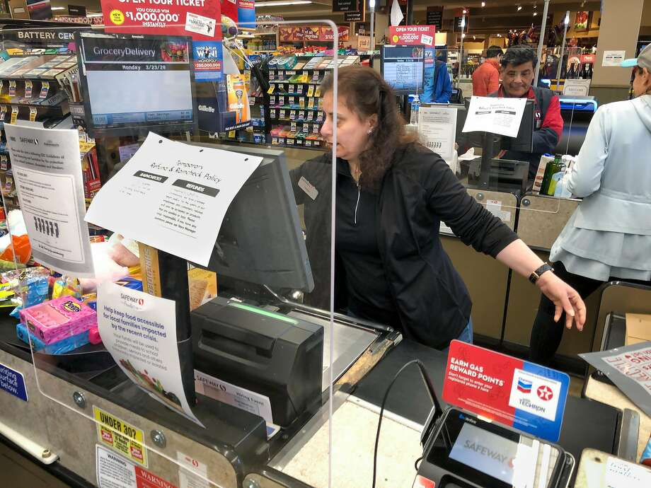 New plexiglass screens keep checkers and customers more safe from the spread of coronavirus at the Crystal Springs Village Safeway Monday, March 23, 2020, in San Mateo, Calif. Photo: Jim Gensheimer / Special To The Chronicle