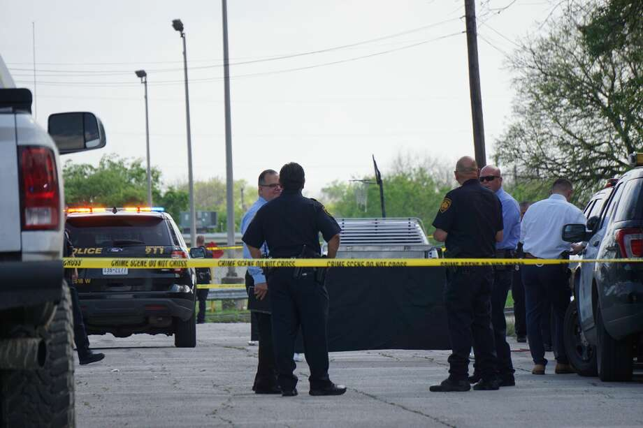 San Antonio Police investigators examine the scene where a man was killed during a confrontation with an officer Monday afternoon, March 23, 2020, on the West Side. The man, in his 40s, confronted the officer with a pickaxe when she arrived at the scene, police said. Photo: Jacob Beltran