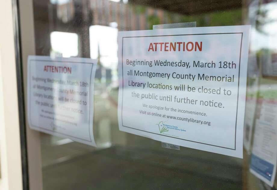 Temporary closure signs were placed at the Montgomery County Public Library in response to COVID-19 in Conroe, Wednesday, March 18, 2020. Due dates for book returns were extended and all library book drops are closed until further notice. Photo: Gustavo Huerta, Houston Chronicle / Staff Photographer / Houston Chronicle © 2020