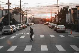 Skateboarders take to the empty streets practicing social distancing during the coronavirus shelter-in-place order.