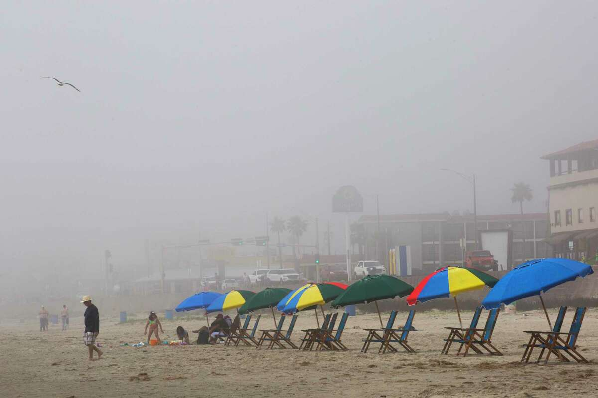 Slowly families start filling the beach chairs at the beach in Galveston early Sunday, March 15, 2020.