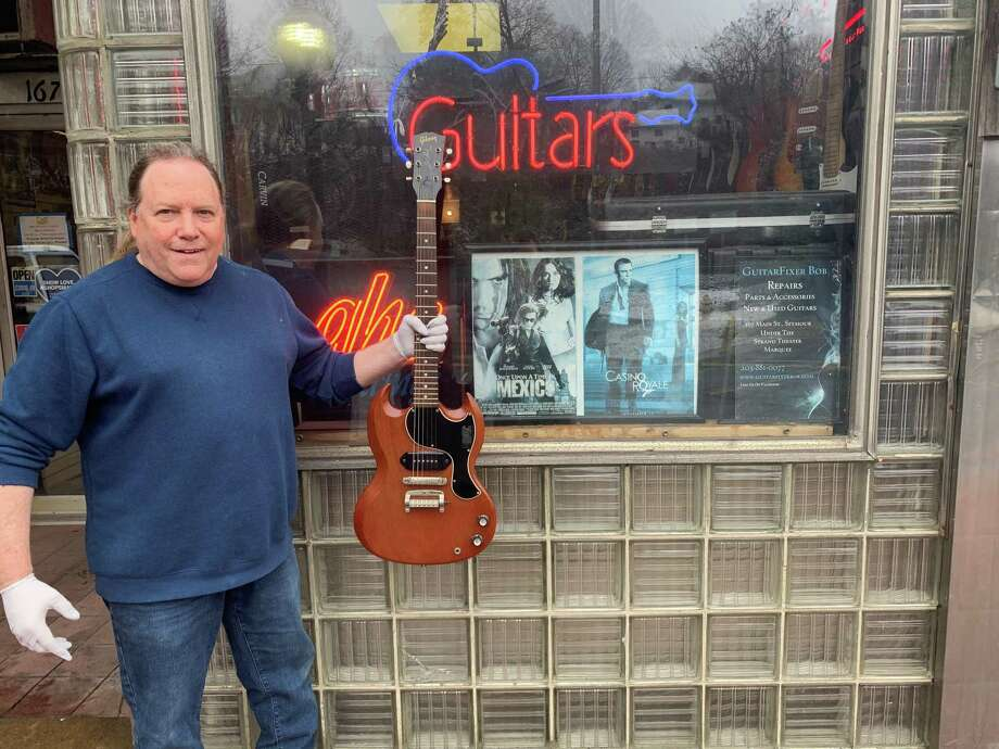 "Luthier Robert Pieper, owner of GuitarFixer Bob, has closed up shop for the foreseeable future after his business was deemed ""non-essential"" by the state during the coronavirus pandemic. Photo: Michael P. Mayko"