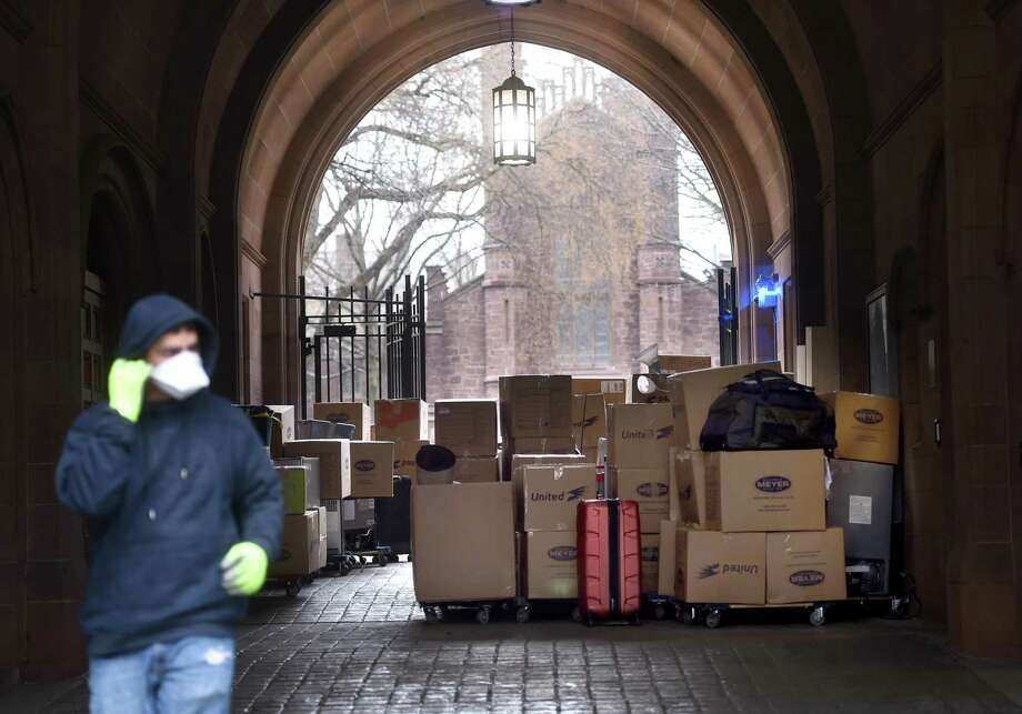 Belongings from the dorms of Yale University students packed up and waiting to be moved to storage sit under the cover of Phelps Gate on Old Campus in New Haven on March 23. Photo: Arnold Gold / Hearst Connecticut Media / New Haven Register