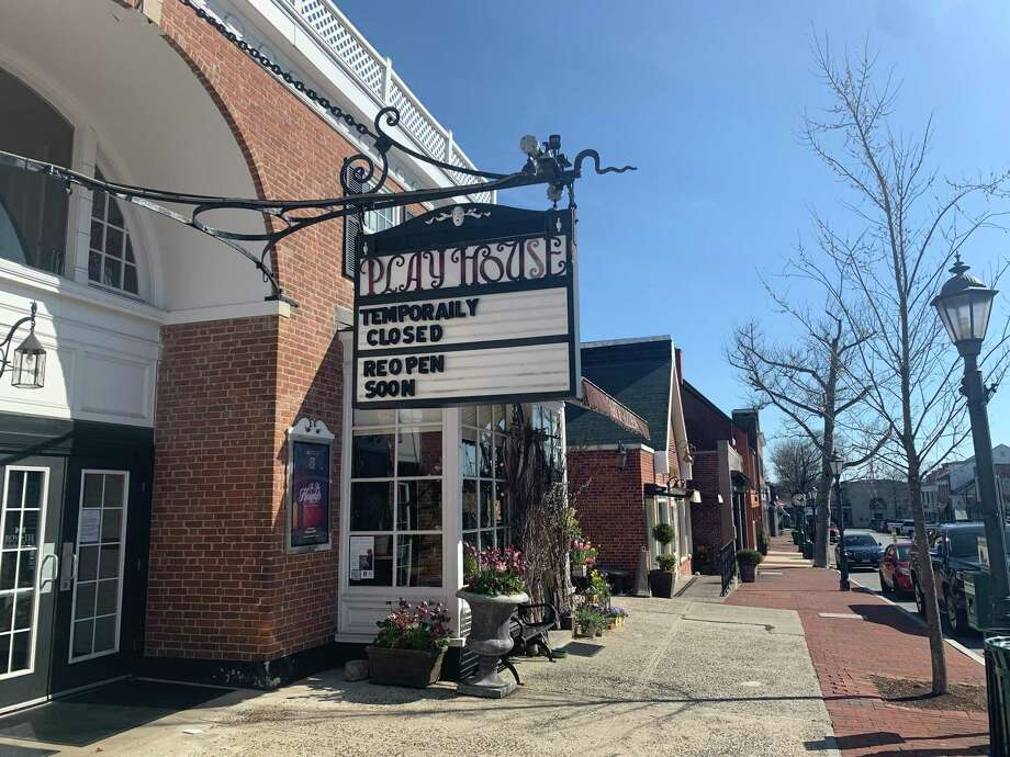 The marquee at the New Canaan Playhouse on an unusually deserted Elm Street recently, reflects the current state of things, and hope for the future. Photo: John Kovach / Hearst Connecticut Media / New Canaan Advertiser