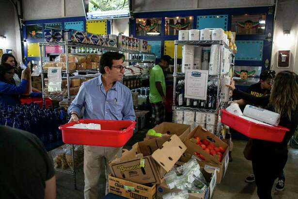 Robert Garcia shops at La Gloria in San Antonio, Texas, on March 23, 2020. Some local restaurants have created makeshift grocery stores amid coronavirus related shut downs.