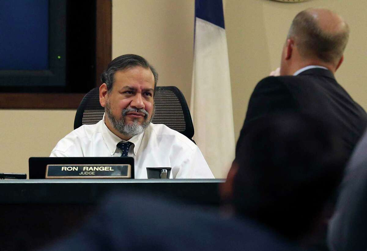 Judge Ron Rangel of 379th State District Court presides over defense attorney Albert Gutierrez, Jr. (right) and prosecutors Josh Somens (left) and Matthew Ludowig (second from left) as jurors proceed with another day of deliberations for the murder trial of Gabriel Moreno on Thursday, Mar. 8, 2018. Jurors continued deliberations on Thursday on whether to convict Moreno, a San Antonio man, of murder in a 2014 baseball bat-beating of Jose Luis Menchaca who was later suffocated, dismembered and his remains grilled on a barbecue pit. (Kin Man Hui/San Antonio Express-News)