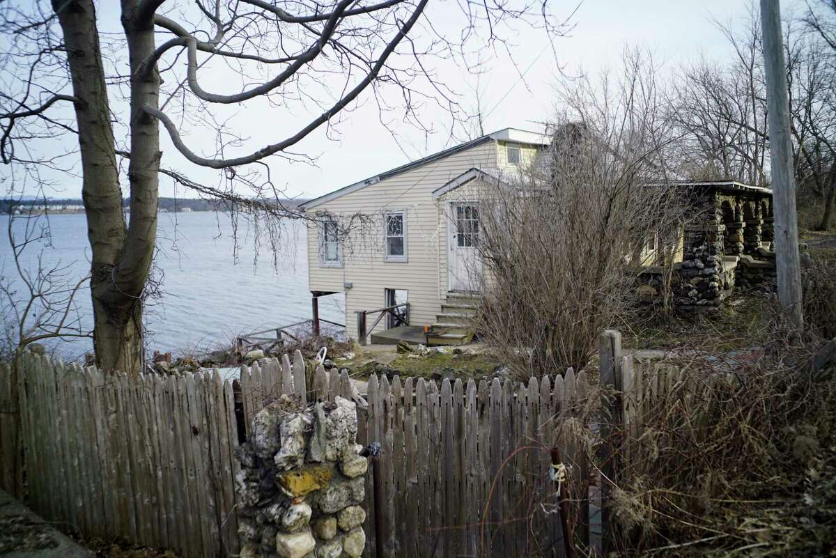 A view of the home located at 1191 Route 9P along Saratoga Lake on Monday, March 23, 2020, in the Town of Saratoga, N.Y. The property owners wanted to demolish this home and build a larger home on the land. The owners lost a lawsuit and so now they will not be able to build the larger home. (Paul Buckowski/Times Union)