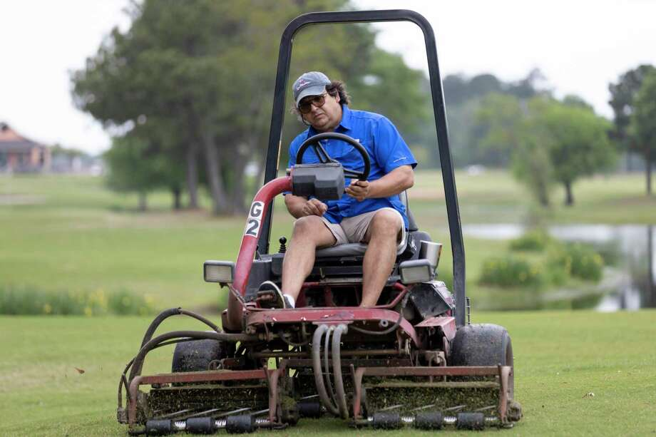 David Preisler, owner of Oakhurst, River Plantation and West Fork Golf Club cuts the grass at tee 18, Tuesday, March 23, 2020. Preisler has taken extra responsibilities since having to let go of some staff in response to COVID-19. Photo: Gustavo Huerta, Houston Chronicle / Staff Photographer / Houston Chronicle © 2020