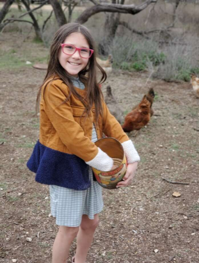 Averi Click, a student at Greenwood Intermediate School, collects eggs for donation to Greenwood ISD food pantry. Photo: Courtesy Photo