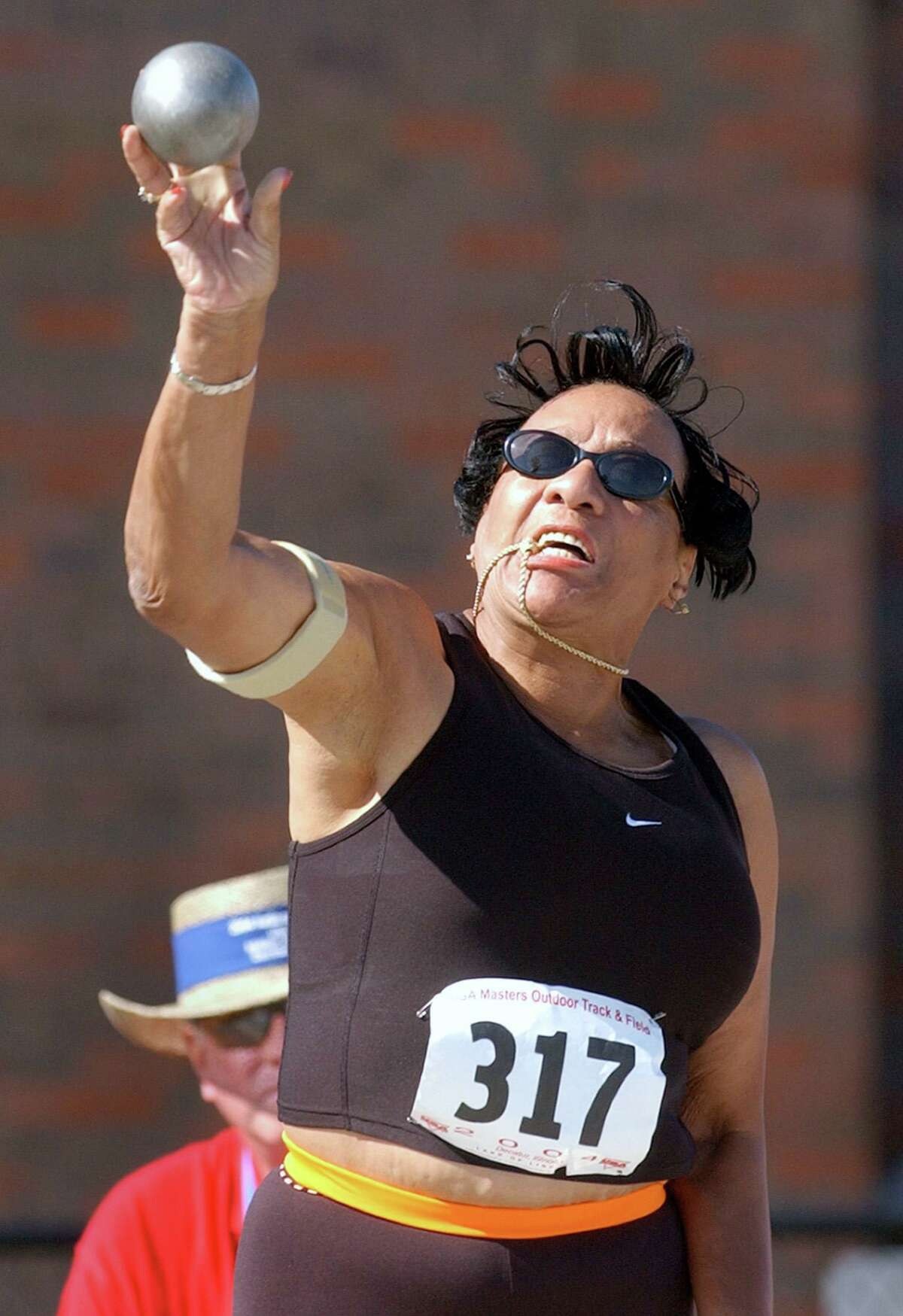 Mary Roman, of Norwalk, Conn., makes a shot put attempt Thursday, Aug. 5, 2004, at the USA Masters Outdoor Track & Field competition in Decatur, Ill.