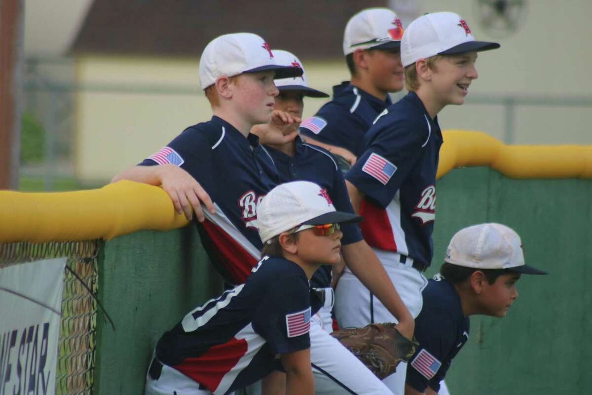The Bayside 12-year-old all-stars congregate against the outfield fence in Santa Fe, prior to the 2019 championship game.