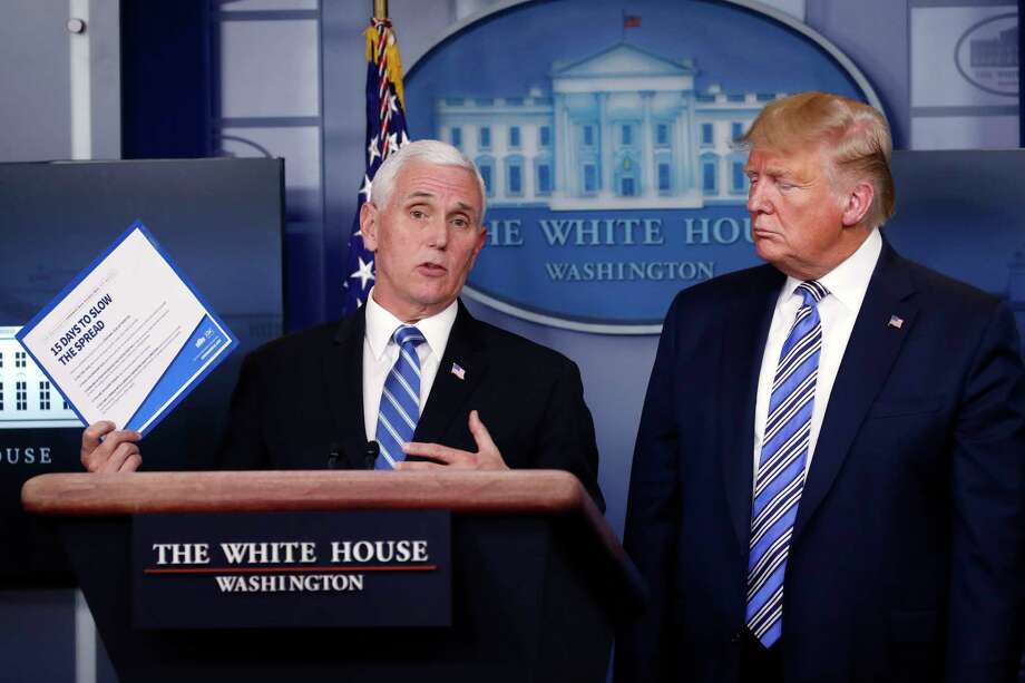 President Donald Trump listens as Vice President Mike Pence speaks about the coronavirus in the James Brady Briefing Room, Monday, March 23, 2020, in Washington. Photo: Alex Brandon, AP / Copyright 2020 The Associated Press. All rights reserved.