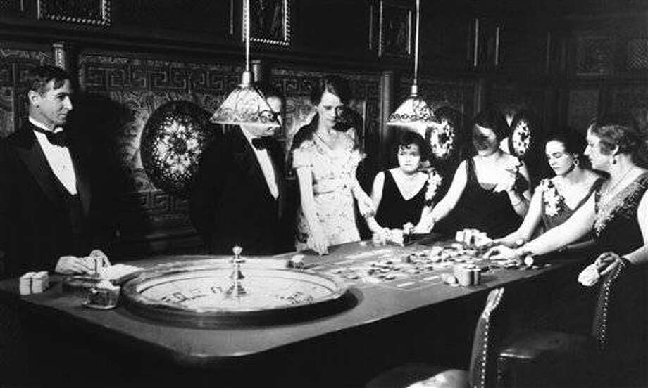 Photo shows gambling in full dress marked the first operation under Nevada?s new Sky-Limit gambling law at one of Reno?s fashionable suburbs in Reno, Nevada, on Saturday, night, March 24, 1931. Here is a roulette table with a few patrons. (AP Photo)
