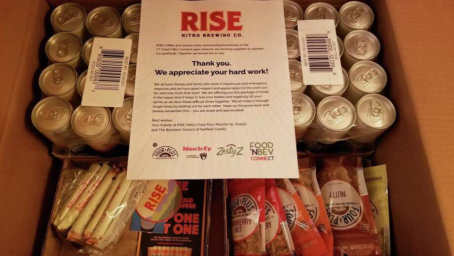 Stamford-based RISE Brewing Co. partnered with Kelly's Four Plus Granola, Muscle Up Bars, and Zesty Z popcorn to create 30 care packages for healthcare and emergency response workers. Photo: Contributed Photo