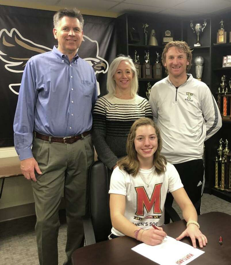 Avery Rice was joined by dad Conway, mom Marybeth and Trumbull head girls' soccer coach Rich Sutherland when she signed her letter of intent to play soccer at Maryland University. Photo: Contributed Photo / Trumbull High Athletics / Trumbull Times