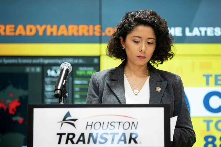 "Harris County Executive Lina Hidalgo looks at her notes before starting a press conference announcing that the county will adopt a ""Stay Home, Work Safe"" strategy until April 3, Tuesday, March 24, 2020, at TranStar in Houston."