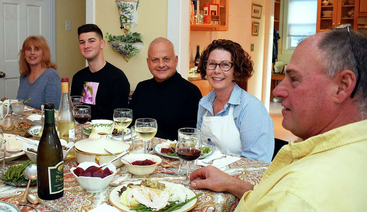 Hospitalman Keaton Whelan enjoys Thanksgiving dinner with Guy and Michelle Di Cesare and family, Nov. 28 in New London.