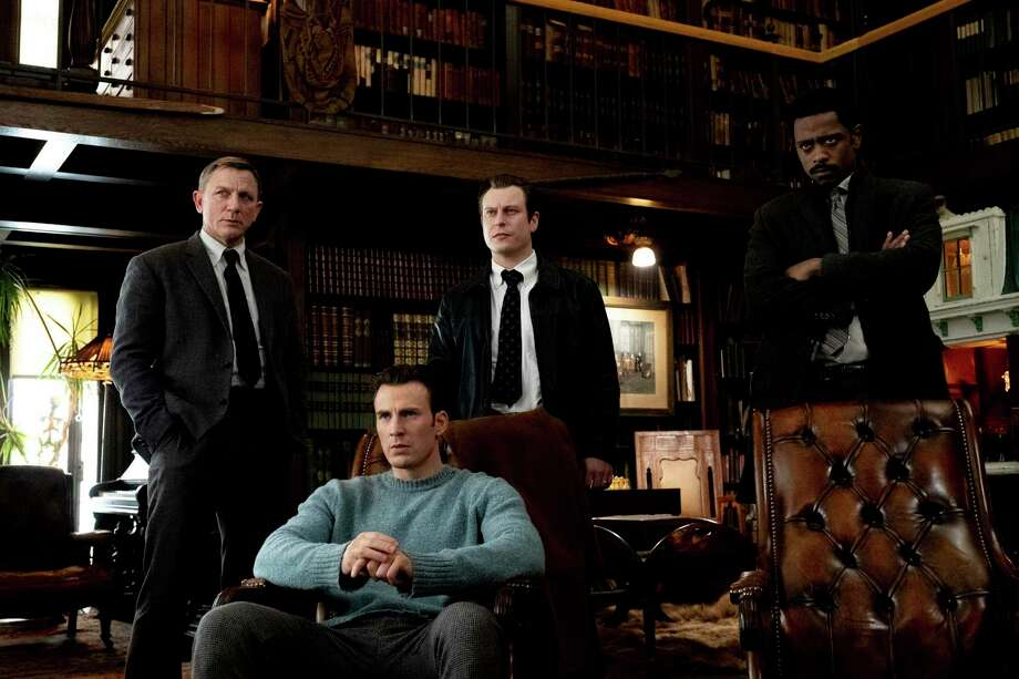 "This image released by Lionsgate shows Daniel Craig, from left, Chris Evans, Noah Segan and Lakeith Stanfield in a scene from ""Knives Out."" (Claire Folger/Lionsgate via AP) Photo: Claire Folger / AP / © 2018 MRC II Distribution Company L.P. All rights reserved."