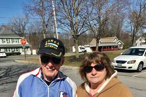 Fred Malone, 89, and his wife, Sue, 72, outside their senior apartment in Guilderland. They fear they may go into lockdown, which would deprive Malone of his daily four-mile walk to combat the effects of Parkin's disease.