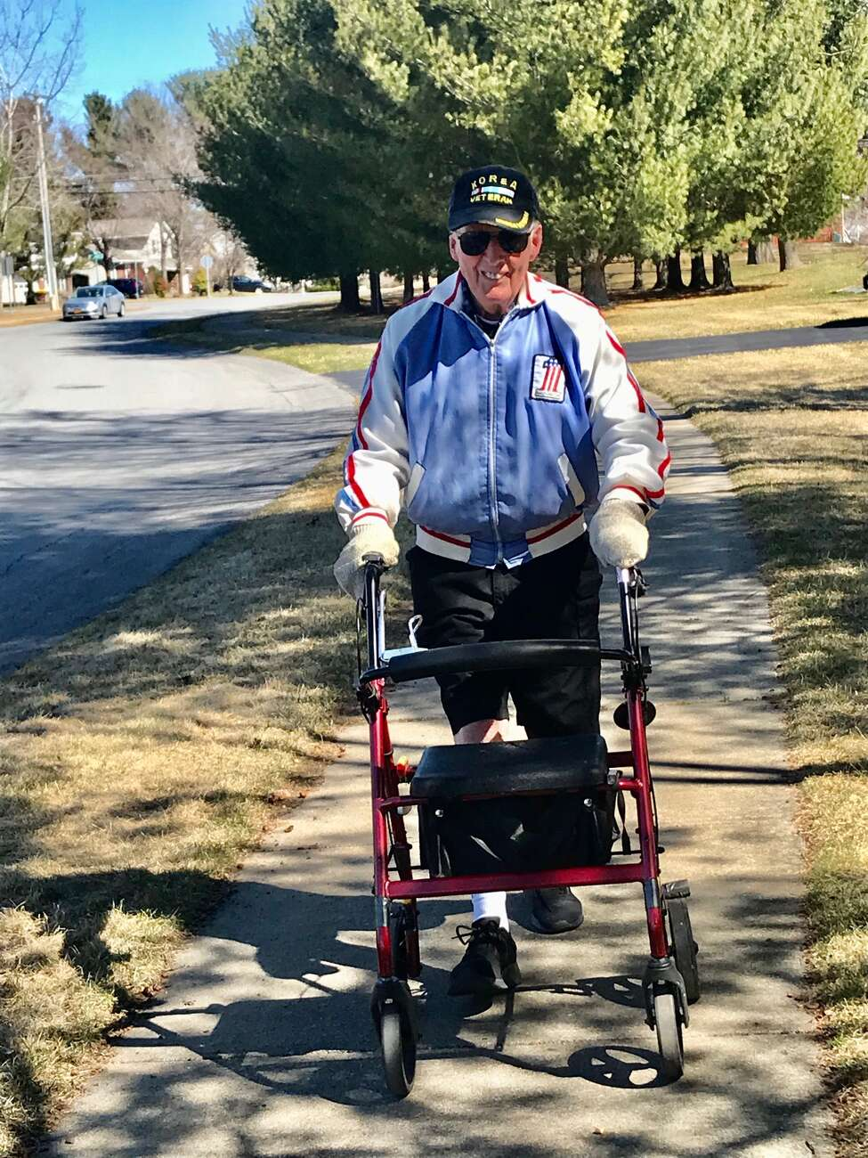 Fred Malone plays upbeat music on his radio to keep his pace up on his daily four-mile walk.