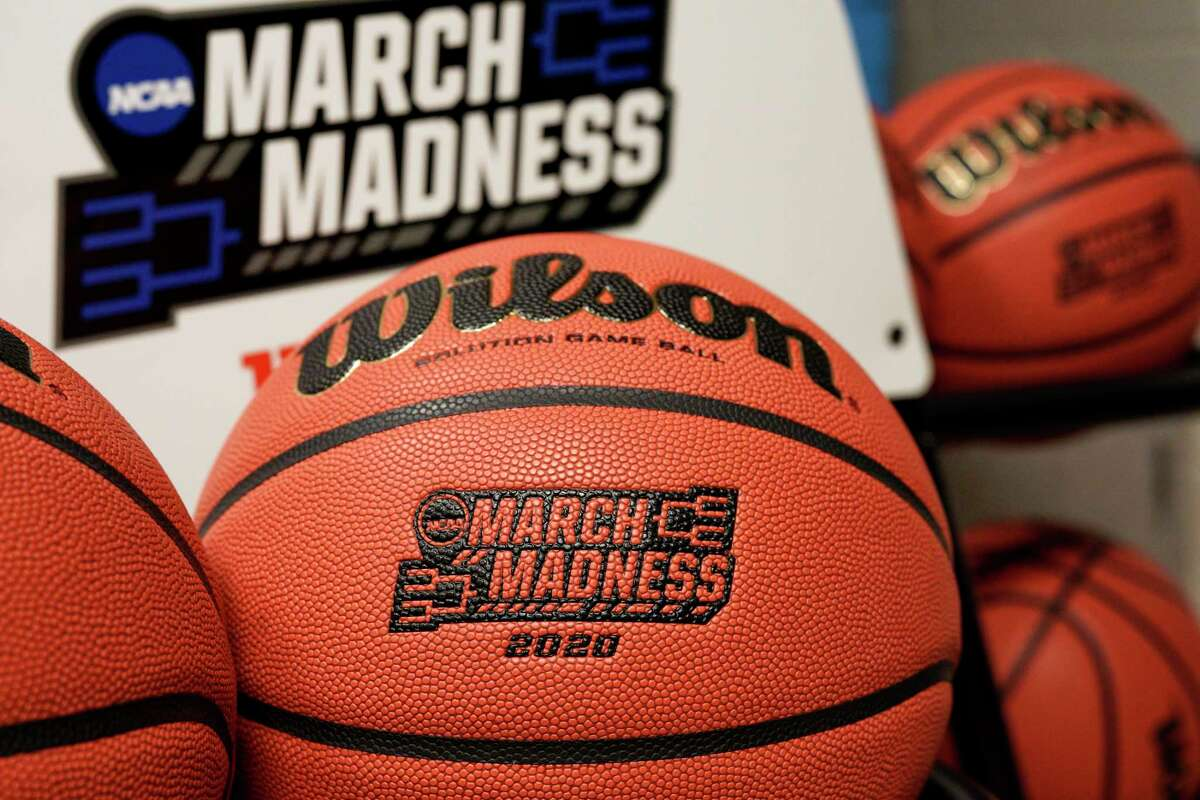 Official March Madness 2020 tournament basketballs are seen in a store room at the CHI Health Center Arena, in Omaha, Neb., Monday, March 16, 2020. Omaha was to host a first and second round in the NCAA college basketball Division I tournament, which was cancelled due to the coronavirus pandemic. (AP Photo/Nati Harnik)