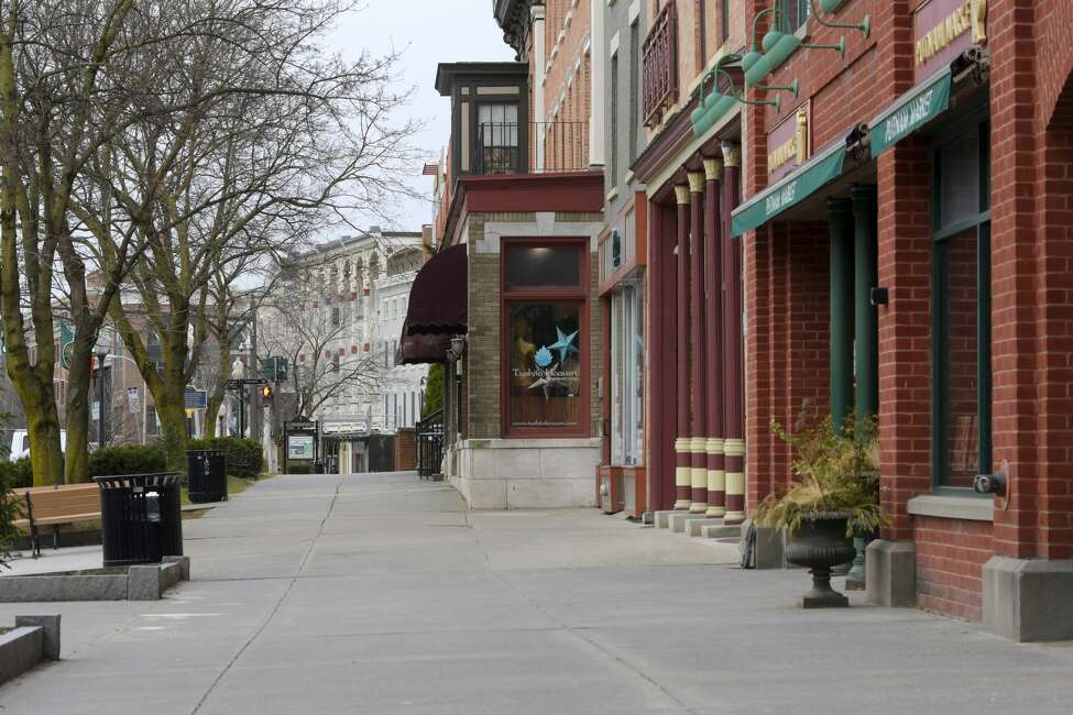 A view look down an empty section of Broadway on Monday, March 23, 2020, in Saratoga Springs, N.Y. Monday was the first day that all nonessential businesses needed to close. (Paul Buckowski/Times Union)