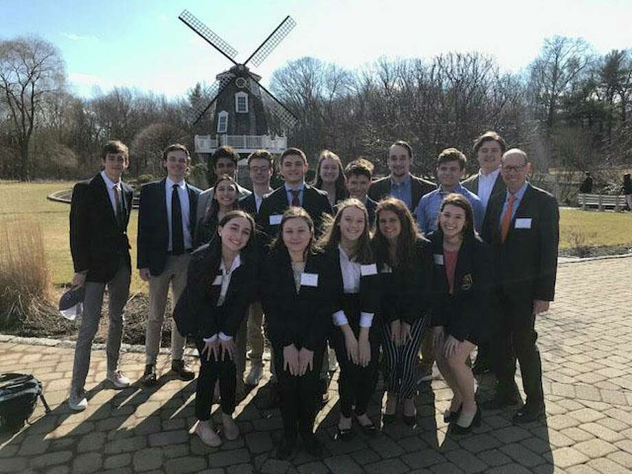 Ridgefield High School DECA Club members: front row, Alexia Anglade, Emily Buonocore, Kate Dougherty, Alyssa DeStefano, Sophie Reale; second row, Madeline Edgerly, Gianni Coraci, Jack McGuire, Joseph Suozzi, Keith Brown; and third row, Luke Boylan, Dylan Flood, Diego Rodriguez, Brett Hall, Avery Simoneau, Jack Matthews, Brennan Ward. Photo: Contributed Photo