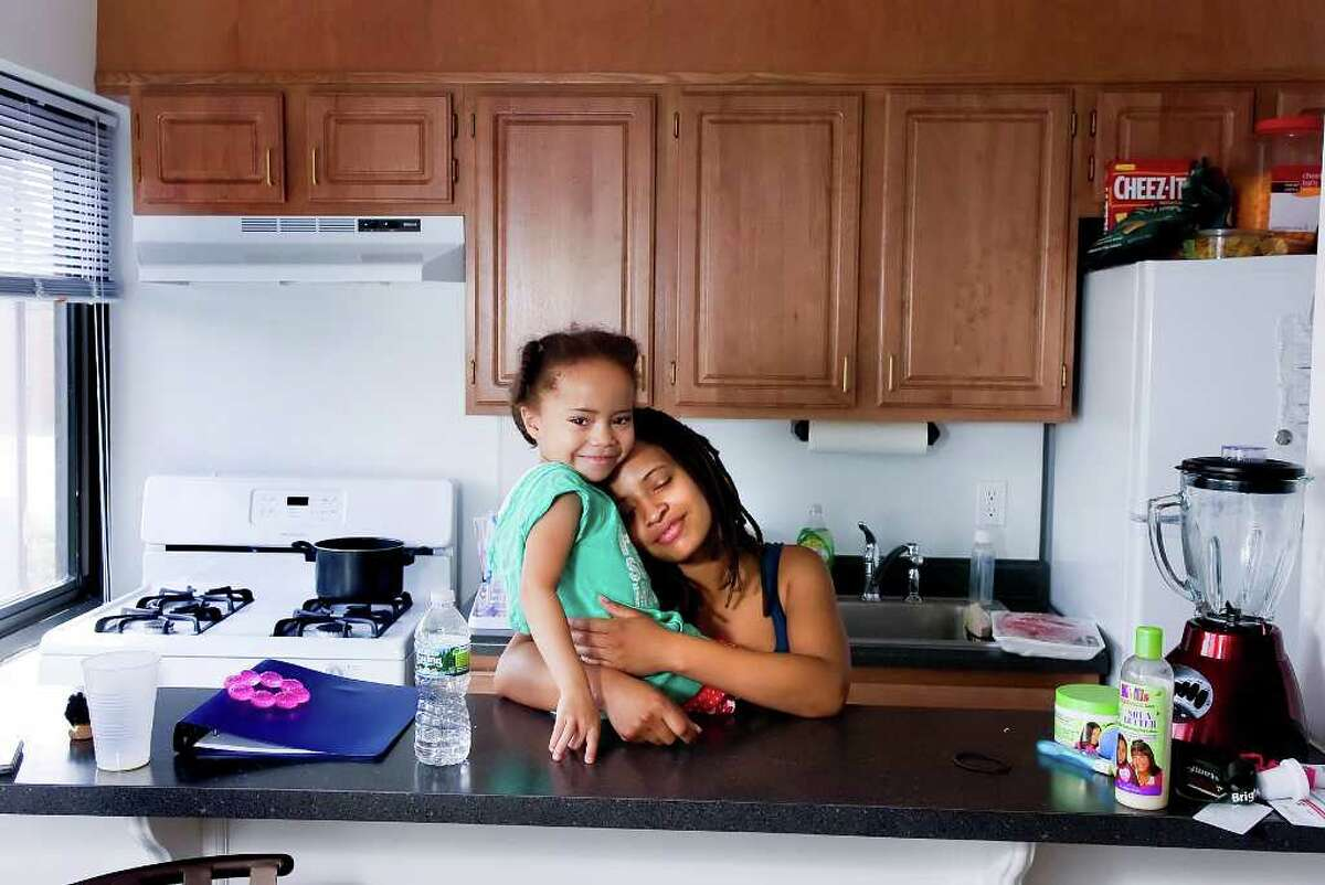 Sasha Rivera, 24, and her daughter Symone Williams, 4, in their new apartment at the Friendship House on Wednesday, August 17, 2010. Rivera was recently certified as a nurse's assistant and has since saved enough money to move out of the temporary shelter at St. Luke's LifeWorks with her two young daughters. She moved into her new place Aug. 11.
