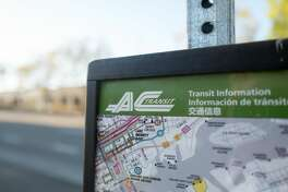 Close-up of map with logo for AC Transit bus system at a bus stop on Alameda Island, Alameda, California, September 10, 2018.