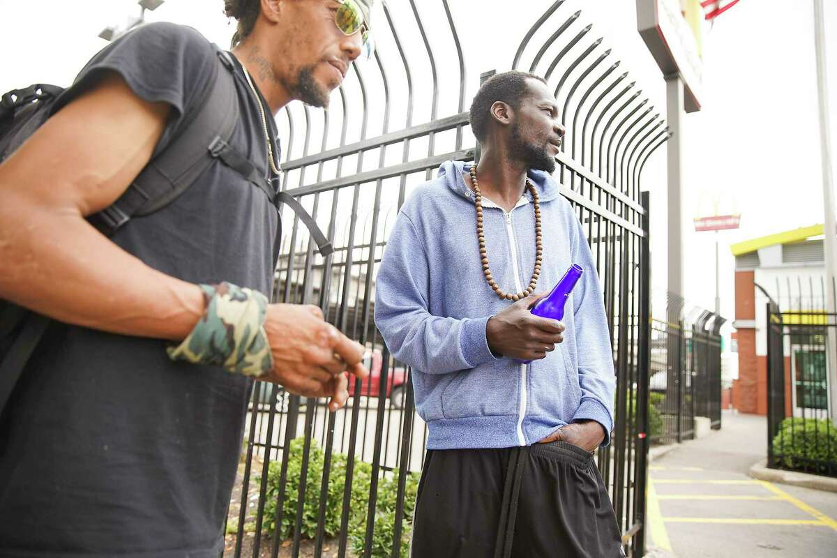 Local men who are homeless hang out on Main Street in downtown Houston.