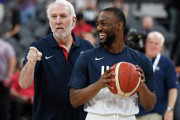 Gregg Popovich, the U.S. coach for 2020, talks with Kemba Walker before an exhibition last summer. Pushing the Olympic games back to 2021 could cause conflicts with the NBA schedule.