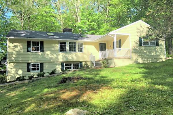 The ranch-style cottage at 29 High Meadow Road in Lower Weston sits at the end of a quiet cul-de-sac on a two-acre level and lightly wooded property.