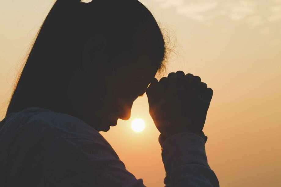 Young woman praying. Photo: Dreamstime / (c) Lekjorruang | Dreamstime.com