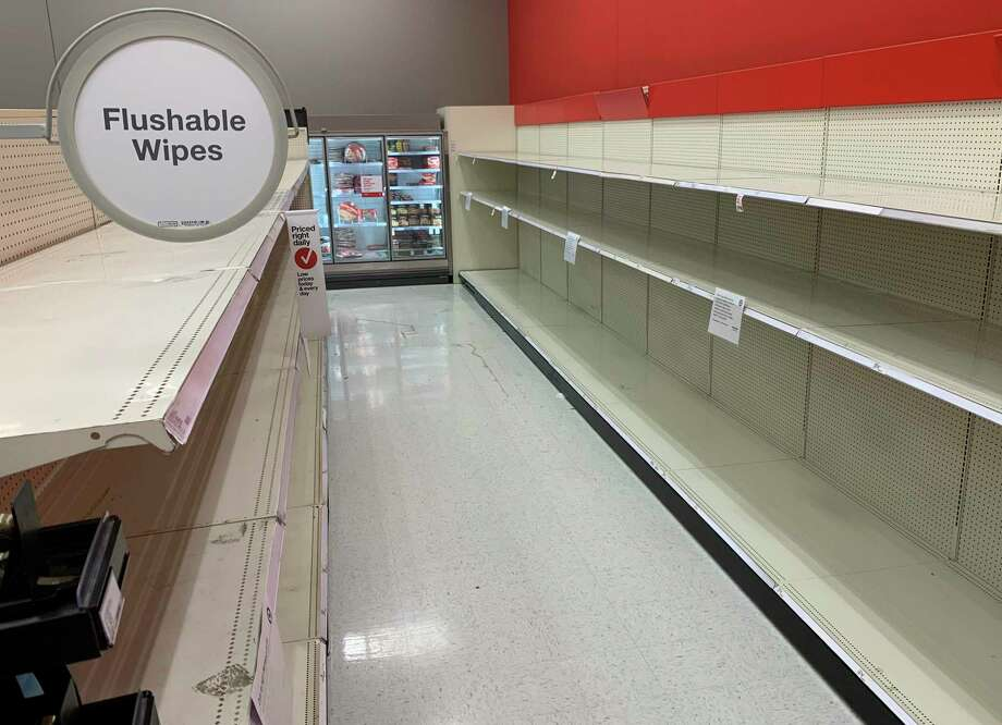 An aisle once stocked with flushable wipes and toilet paper sits emptied at a Target store. Photo: Laurie Skrivan / Associated Press / St. Louis Post-Dispatch