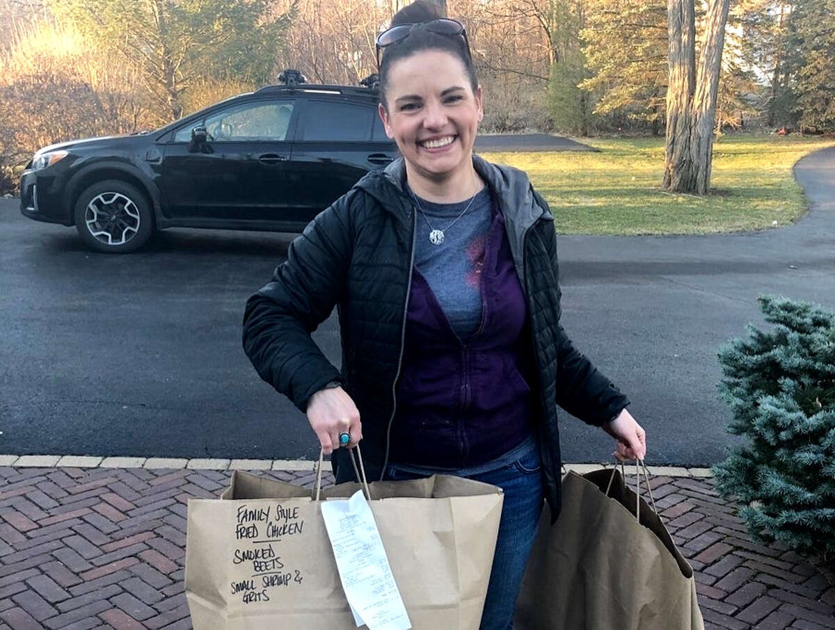 Casey O'Leary from The Cuckoo's Nest in Albany makes a delivery of food last week.