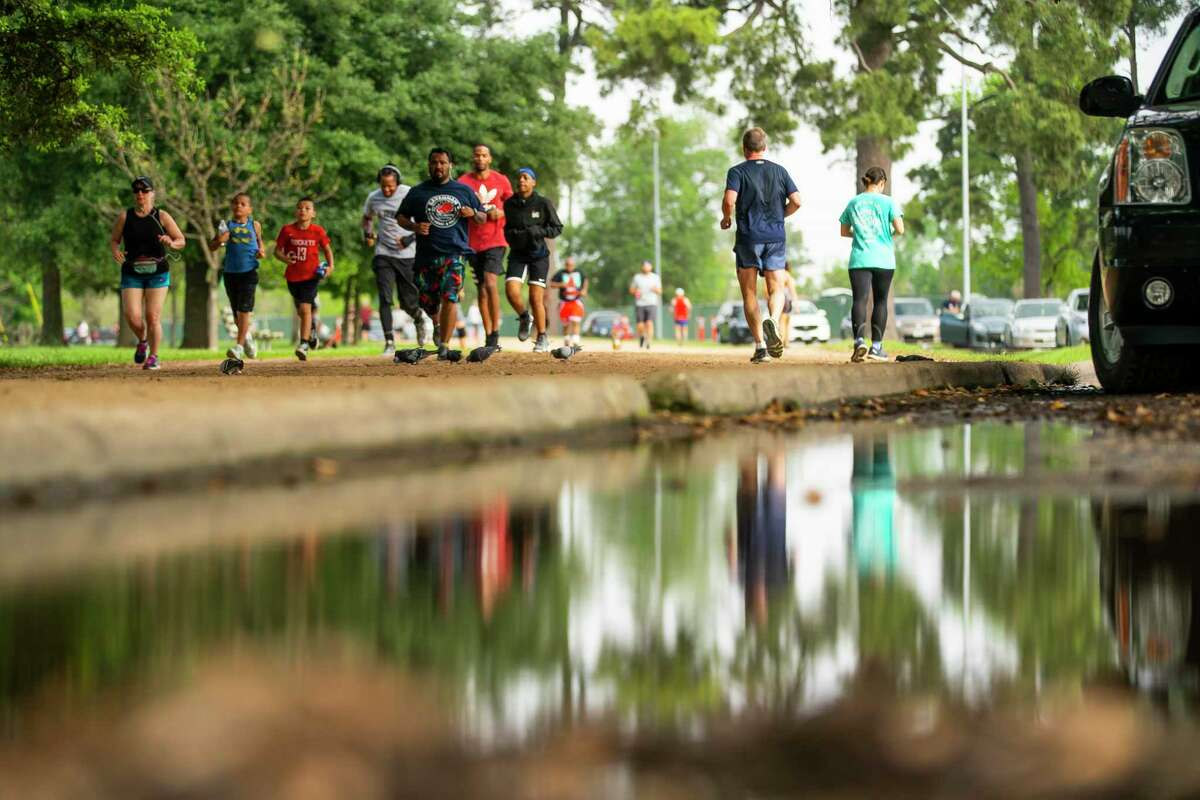People run on the Seymour Lieberman Trail, Tuesday, March 24, 2020, at Memorial Park in Houston.