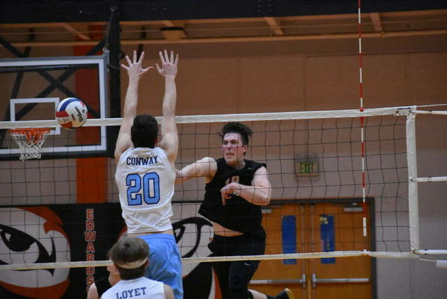 Edwardsville's Josh Whittenburg slams down a kill during a match last season against Belleville East inside the Lucco-Jackson Gymnasium. Photo: Matt Kamp|The Intelligencer