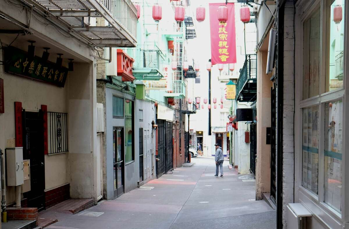 FILE - The store owner Kevin Chan walks in the alley where his Golden Gate Fortune Cookie Factory is located in San Francisco's Chinatown, California, the United States, March 20, 2020.