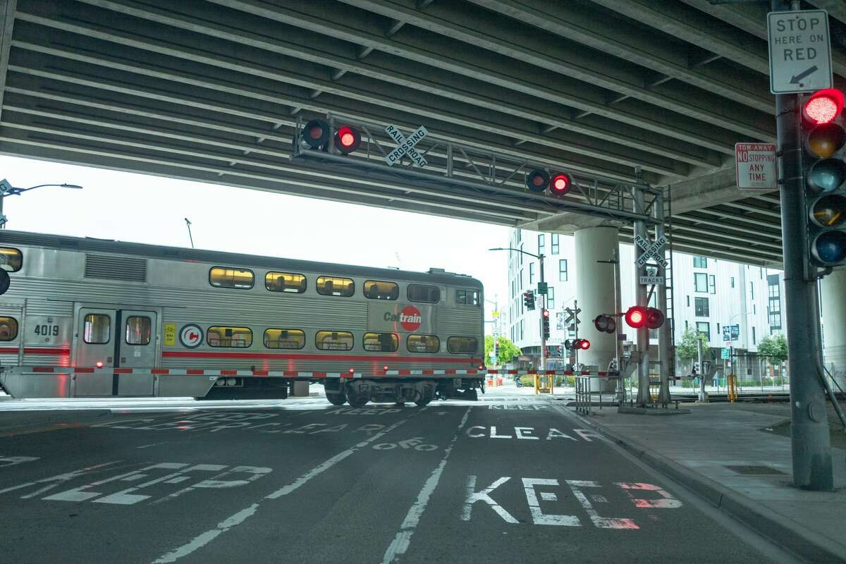 A nearly empty Caltrain train passes through a level crossing during an outbreak of the COVID-19 coronavirus in San Francisco, California, March 23, 2020. (Photo by Smith Collection/Gado/Getty Images)