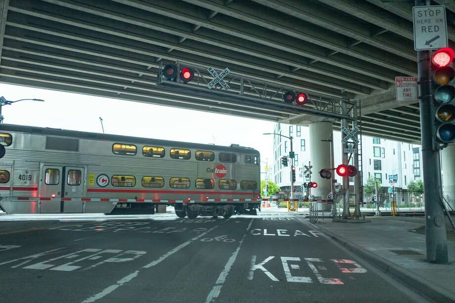 A nearly empty Caltrain train passes through a level crossing during an outbreak of the COVID-19 coronavirus in San Francisco, California, March 23, 2020. Photo: Smith Collection/Gado/Gado Via Getty Images