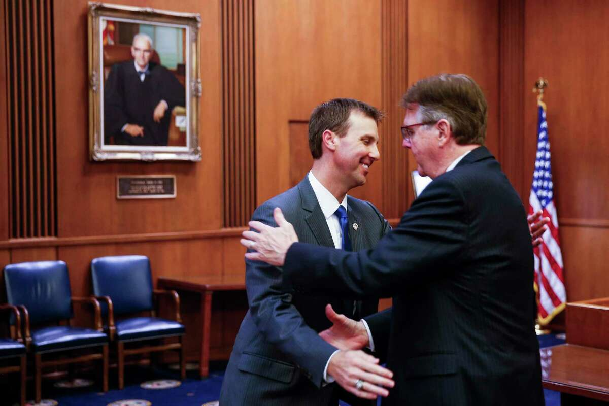 United States Attorney for the Southern District of Texas Ryan K. Patrick, left, hugs his father, Lieutenant Governor of Texas Dan Patrick, after Ryan was sworn in at an investiture ceremony at the Federal Courthouse Tuesday Sept. 18, 2018 in Houston.